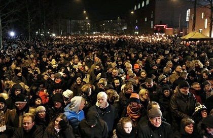 Some 30,000 people gathered in Copenhagen Monday to commemorate the victims of twin shootings that shocked the nation, with the Danish premier telling the ...