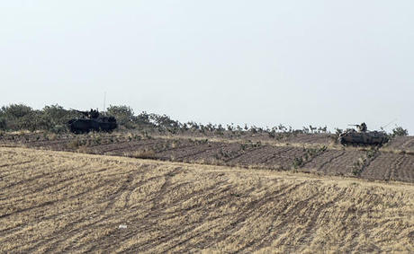 Turkish forces bombard northern Syria areas controlled by Kurdish militia