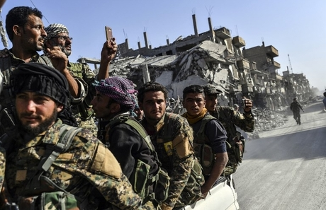 Kurdish-led group to work with Syrian on ending war