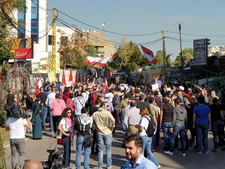 Lebanon: Hezbollah backers attack anti-government protesters with clubs, metal rods